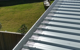 gutter protection for steel roofs